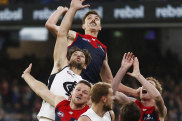 MELBOURNE, AUSTRALIA - MAY 16: Jake Lever of the Demons, Levi Casboult of the Blues, Steven May of the Demons, Harrison Petty of the Demons and Harry McKay of the Blues compete for the ball during the 2021 AFL Round 09 match between the Melbourne Demons and the Carlton Blues at the Melbourne Cricket Ground on May 16, 2021 in Melbourne, Australia. (Photo by Dylan Burns/AFL Photos via Getty Images)