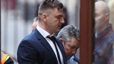 Milos Novakovic is taken into the Supreme Court on Friday