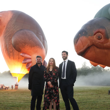 "NGA director Nick Mitzevich, at left, artist Patricia Piccinini and NGA council chair Ryan Stokes with ""Skywhalepapa"" during a test flight at a property in Gundaroo, NSW."