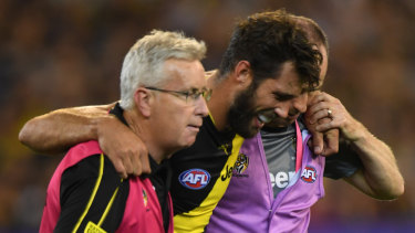 Tiger defender Alex Rance is helped from the field in the match against Carlton.
