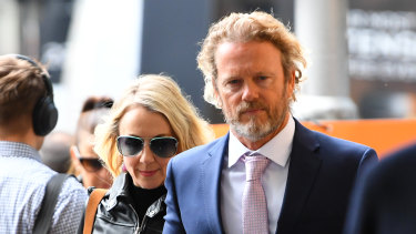 Australian actor Craig McLachlan and his partner Vanessa Scammell arrive at the Melbourne Magistrates Court on Thursday.