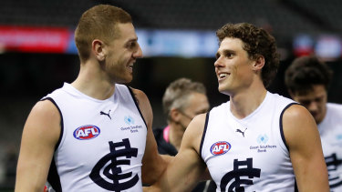 Liam Jones and Charlie Curnow walk off the ground victorious after their win over the Saints.