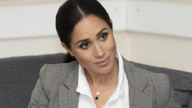 Meghan Markle wearing Natalie Marie initial necklace while in Australia in October 2018.