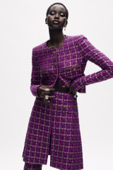 Adut Akech in a tweed suit as part of Chanel's digital haute couture presentation.