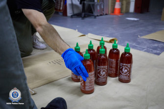 About 400kg of ice was suspended inside bottles of Sriracha chilli sauce.