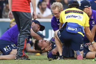 An injured Ryan Papenhuyzen during Sunday's Storm-Dragons clash.