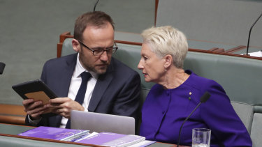 Greens MP Adam Bandt and independent MP Kerryn Phelps negotiate during Question Time.