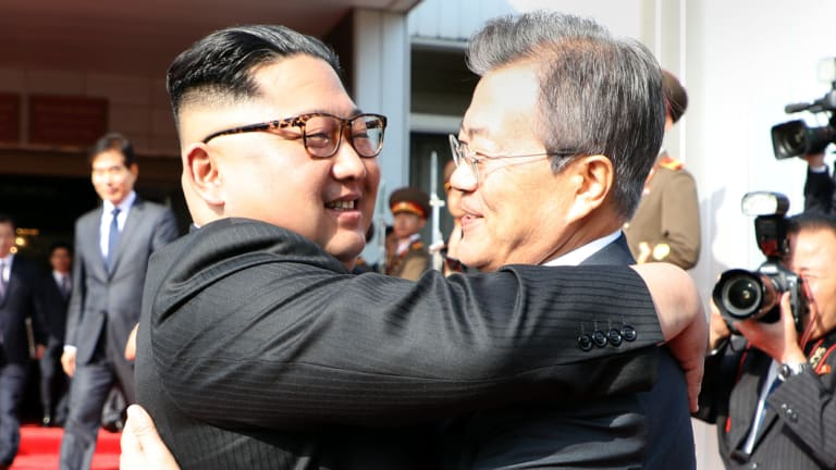 North Korean leader Kim Jong-un embraces South Korean President Moon Jae-in after their summit in the Demilitarised Zone on May 26.