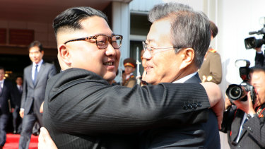 North Korean leader Kim Jong-un embraces South Korea's President Moon Jae-in after their summit in the Demilitarised Zone on May 26.