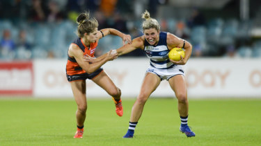 Ellie Brush pressures Melissa Hickey of the Cats.