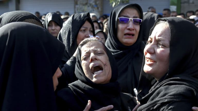 """Families of a terror attack on a military parade in the south-western city of Ahvaz mourn at a mass funeral ceremony.  A Norwegian citizen of Iranian descent was arrested on suspicion of helping an unspecified Iranian intelligence service """"to act in Denmark"""" against the Arab Struggle Movement for the Liberation of Ahwaz, blamed for the attack."""