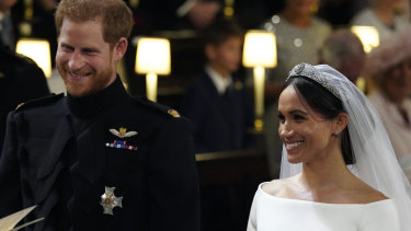 The happy couple: Prince Harry and Meghan Markle grin during the wedding ceremony.