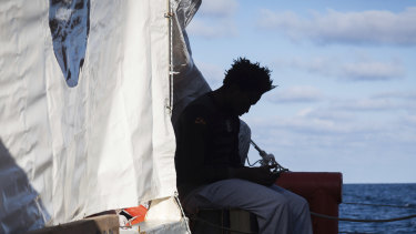 A migrant rescued from the Mediterranean Sea in December.