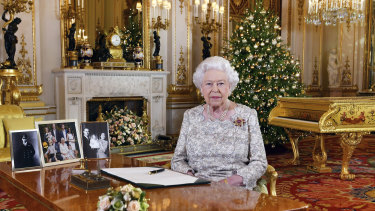 Queen Elizabeth poses for a photograph after recording her annual Christmas Day message, in the White Drawing Room of Buckingham Palace.