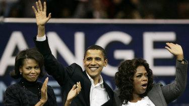 Michelle Obama, left, and Oprah Winfrey with the then Democratic presidential hopeful, Barack Obama, in 2007.