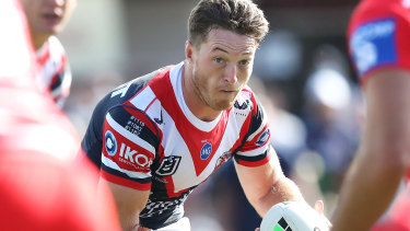Sam Verrills runs the ball for the Roosters.