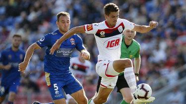 Open space: George Blackwood of United makes a break past Ben Kantarovski.