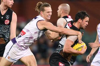 Travis Boak is tackled by Fremantle's Nat Fyfe.