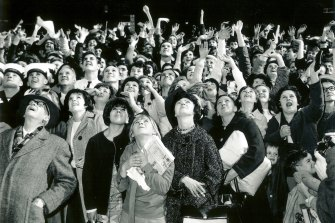 The crowd waits anxiously for the Beatles to appear at the Melbourne Town Hall in 1964.