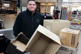 Sam Keeley with some boxes for customers.