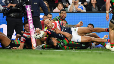 Match-winner: Blake Ferguson dives over in the corner for one of the Roosters' three tries.