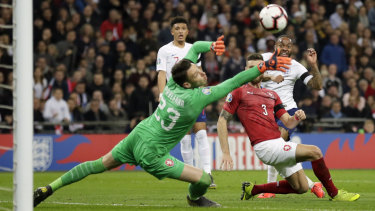 Sterling gets past the keeper to score England's third goal.