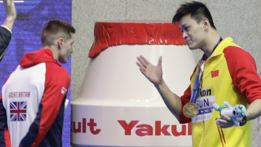 Gold medalist China's Sun Yang confronts  Britain's Duncan Scott after medal ceremony.