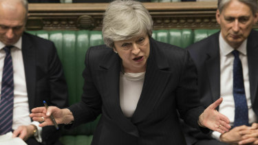 Britain's Prime Minister Theresa May speaks in the House of Commons on Wednesday as moves to oust her intensified.