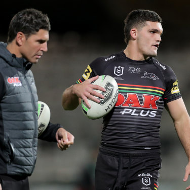 Panthers assistant Trent Barrett with halfback Nathan Cleary before last week's game against South Sydney.
