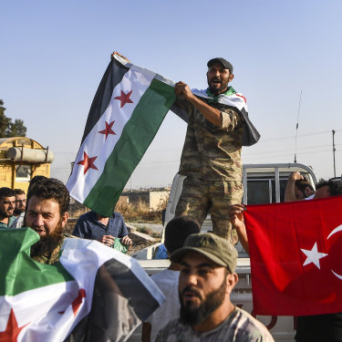 Turkish-backed Syrian National Army fighters in Akcakale on October 13.