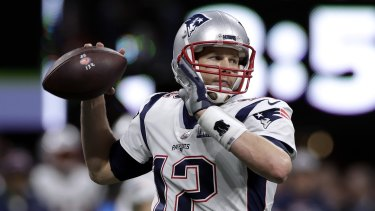 Good company: Holmes could be lining up alongside six-time Super Bowl champion Tom Brady at New England.