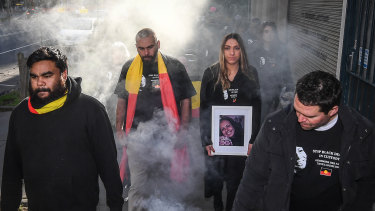 Tanya Day's family and supporters take part in a smoking ceremony ahead of the 2019 inquest into her death.