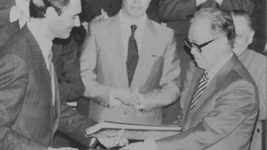 Portugese Prime Minister Anibal Cavaco Silva and Chinese Premier Zhao Ziyang exchange signed copies of an agreement under which Portugal will return Macao to Chinese control in 1999. April 13, 1987.