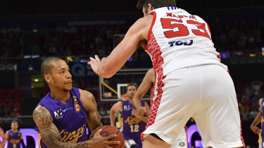 Obstacle: Jerome Randle meets a roadblock in the form of Damian Martin.