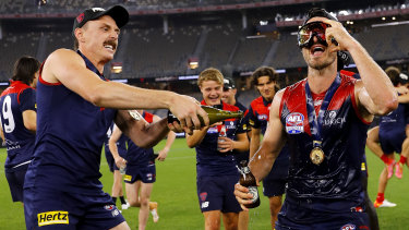 Jake Lever and Alex Neal-Bullen celebrate their premiership win on the Optus Stadium turf.