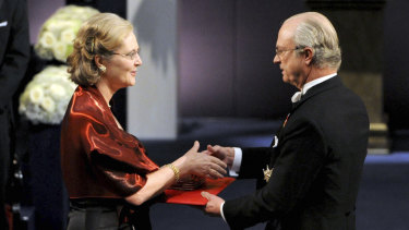 Australian born Professor Elizabeth H. Blackburn, left, receives the Nobel Prize in Medicine from King Carl XVI Gustaf of Sweden in 2009.