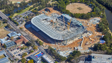 Drone photos showing construction progress of Western Sydney Stadium.