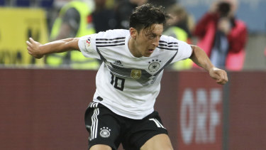 Controversial: Mesut Ozil playing for Germany in a friendly against Austria earlier this year.