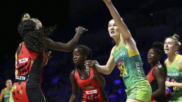 Australia's Courtney Bruce takes on Malawi's Thandie Galleta in yet another lopsided win for the Diamonds in Liverpool.