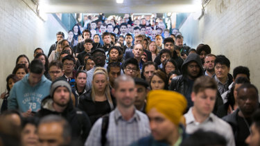 Commuters at Caulfield Station this morning.