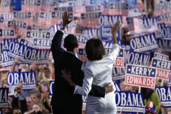 Barack and Michelle Obama wave after the then candidate for the Senate had delivered a keynote address to the Democratic National Convention in July, 2004.