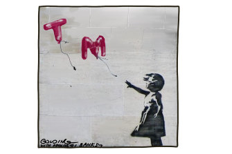 Banksy has launched a bid to protect some of his most famous art from being copied and commercially exploited in Australia.
