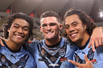 Brian To'o, Jarome Luai and Nathan Cleary of the Blues pose after winning game one.