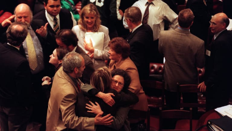 Drug safe injecting room supporters celebrating victory with Ann Symonds hugging a fellow supporter, 1999.