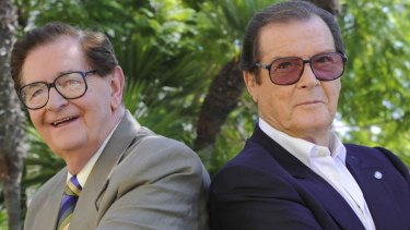 Collins with James Bond star Roger Moore.