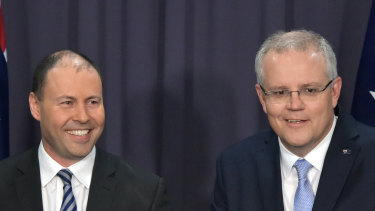 Prime Minister Scott Morrison (right) and deputy Josh Frydenberg have grappled with internal divisions on carbon emissions.