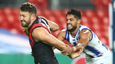 Cale Hooker, left, and Aaron Hall, right, compete in wet conditions at Metricon.