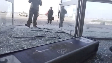 Glass and debris cover the damaged portion of the airport in Yemen's southern city of Aden after an explosion.
