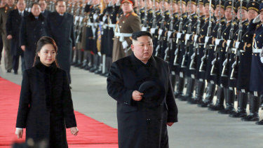 Kim Jong-un and his wife Ri Sol-ju at Pyongyang station before leaving for China.