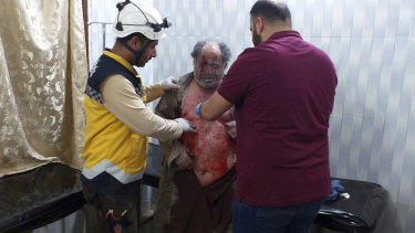 A man injured in an attack on a market receives treatment at a hospital in the village of Ras el-Ain, Idlib province, Syria, last week.